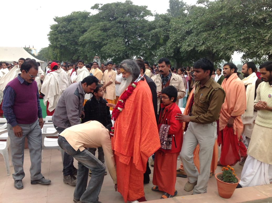 Swamiji entering function amidst chorus of mantras