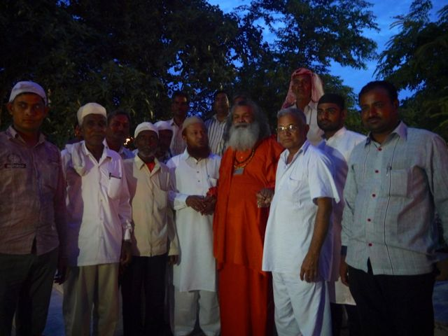 Hindus and Muslims meet in Bari Khatu Ashram at the end of Ramadan