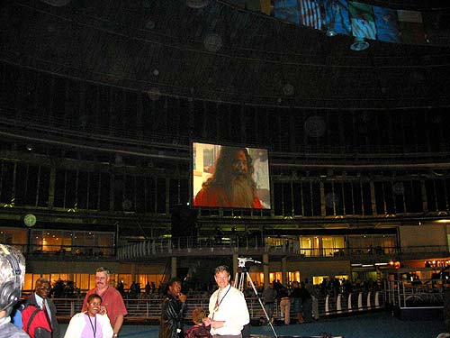 Swamiji on the big screen during presentation