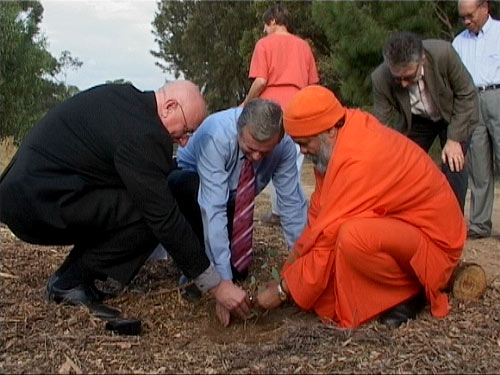 Planting a tree for Peace: Monsignor David Cappo, Premier of South Australia, Mr. Mike Rann, and His Holiness Swamiji